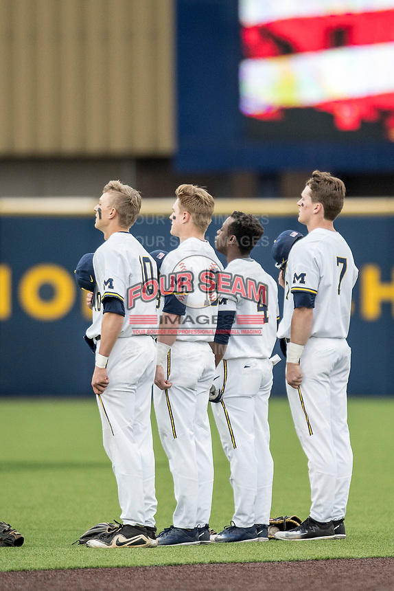 Michigan Wolverines infielders Blake Nelson (10), Jack Blomgren (18), Ako Thomas (4) and Jesse Franklin (7) stand for the national anthem prior to the Big Ten baseball game against the Maryland Terrapins on April 13, 2018 at Ray Fisher Stadium in Ann Arbor, Michigan. Michigan defeated Maryland 10-4. (Andrew Woolley/Four Seam Images)