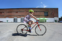 Pictured: Emily Lawson, the daughter of the owners, tests a bike Monday 15 August 2016<br />Re: Frog Bikes in Mamhilad Estate Park in Pontypool, Wales, UK