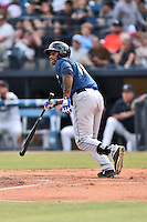 Columbia Fireflies center fielder Ivan Wilson (18) swings at a pitch during a game against the Asheville Tourists at McCormick Field on June 17, 2016 in Asheville, North Carolina. The Tourists defeated the Fireflies 6-2. (Tony Farlow/Four Seam Images)