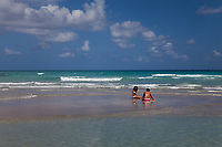 Two Girls Collecting Shells, Fort Lauderdale Beach, Florida, FL, America, USA.