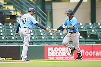 FCL Rays manager Rafael Valenzuela (10) congratulates Mario Fernandez (59) as he rounds the bases after hitting a home run during a game against the FCL Pirates Gold on July 26, 2021 at LECOM Park in Bradenton, Florida. (Mike Janes/Four Seam Images)