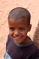 A child is pictured on December 12, 2003, in the Saharawi refugee camps in Aljer. Saharawi people have been living at the refugee camps of the Algerian desert named Hamada, or desert of the deserts, for more than 30 years now. Saharawi people have suffered the consecuences of European colonialism and the war against occupation by Moroccan forces. Polisario and Moroccan Army are in conflict since 1975 when Hassan II, Moroccan King in 1975, sent more than 250.000 civilians and soldiers to colonize the Western Sahara when Spain left the country. Since 1991 they are in a peace process without any outcome so far. (Ander Gillenea / Bostok Photo)