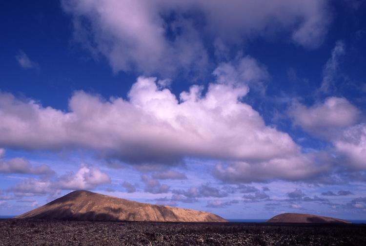 Europe, ESP, Spain, Canary Islands, Lanzarote, National park Timanfaya, Cumulus clouds, Volcanic Landscape