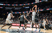 WASHINGTON, DC - FEBRUARY 19: Jamorko Pickett #1 of Georgetown goes up between Maliek White #4 and Kalif Young #13 of Providence during a game between Providence and Georgetown at Capital One Arena on February 19, 2020 in Washington, DC.