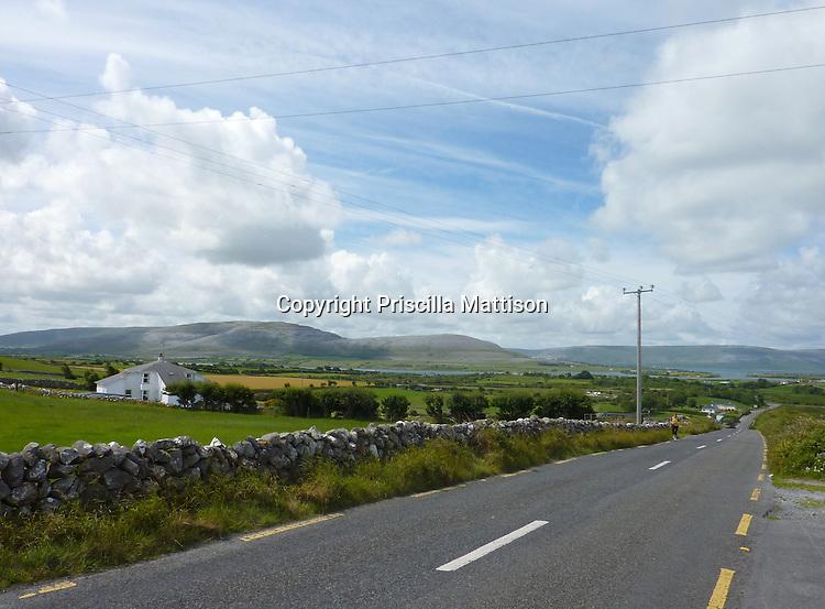 Electric wires criss-cross the wide-open landscape near Kinvara, Ireland.