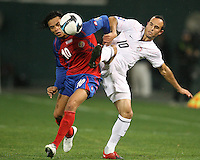 Landon Donovan #10 of the USA battles for a high ball with Walter Centeno #10 of Costa Rica during a 2010 World Cup qualifying match in the CONCACAF region at RFK Stadium on October 14 2009, in Washington D.C.The match ended in a 2-2 tie.