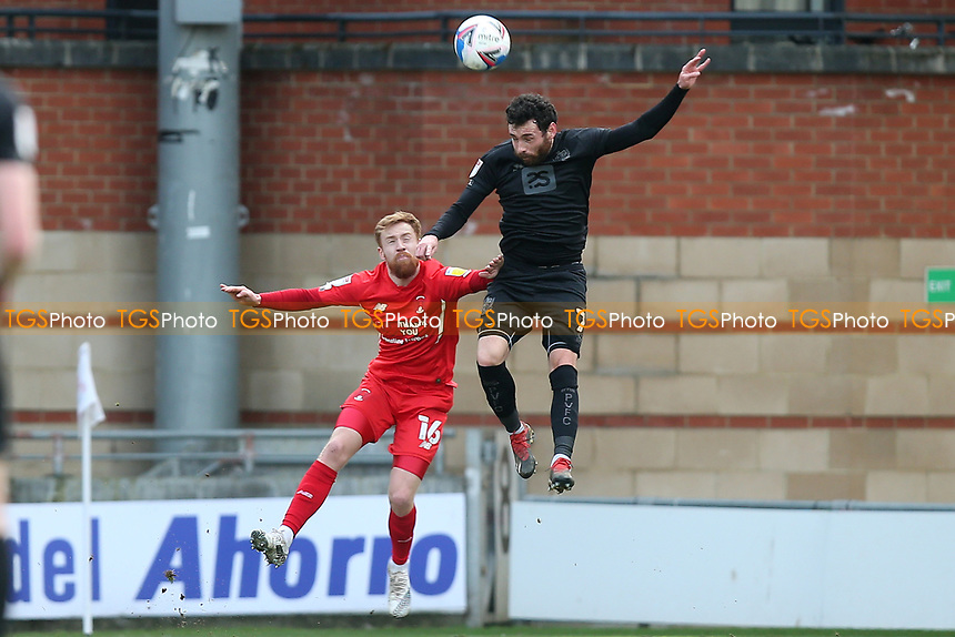 James Brophy of Leyton Orient and David Worrall of Port Vale during Leyton Orient vs Port Vale, Sky Bet EFL League 2 Football at The Breyer Group Stadium on 20th February 2021
