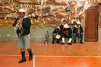Members of the Bolivian Navy band rehearse before their annual carnival celebration. Bolivia lost what is now northern Chile in a war over nitrates leaving Bolivia without access to the ocean.