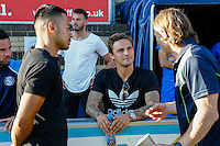 """Gareth Ainsworth Manager of Wycombe Wanderers (left) chats to Sam Saunders (centre) and Nicholas Harry """"Nico"""" Yennaris ahead of the Friendly match between Wycombe Wanderers and Brentford at Adams Park, High Wycombe, England on 19 July 2016. Photo by David Horn PRiME Media Images."""