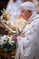 Pope Benedict XVI stands during the Holy Christmas Midndight Mass in the Saint Peter's Basilica late 24 December 2009 in Vatican City... .