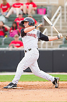 Kyle Eveland #6 of the Kannapolis Intimidators follows through on his swing against the West Virginia Power at Fieldcrest Cannon Stadium on April 20, 2011 in Kannapolis, North Carolina.   Photo by Brian Westerholt / Four Seam Images