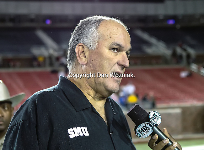Southern Methodist Mustangs head coach,June Jones, gives an interview after the game between the University of Houston Cougars and the Southern Methodist Mustangs at the Gerald J. Ford Stadium in Dallas, Texas. SMU defeats Houston 72 to 42....