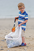Pictured: William Mosley collects litter from the beach. Saturday 09 June 2018<br /> Re: Four year old William Mosley who enjoys collecting plastic litter.
