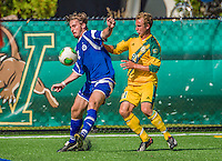 28 September 2013: Hartwick College Hawk Midfielder Jamie O'Grady, a Freshman from Falkirk, Scotland, in action against Midfielder Danny Childs (21), a Sophomore from Colorado Springs, CO, of the University of Vermont Catamounts at Virtue Field in Burlington, Vermont. The Catamounts shut out the visiting Hawks 1-0. Mandatory Credit: Ed Wolfstein Photo *** RAW (NEF) Image File Available ***
