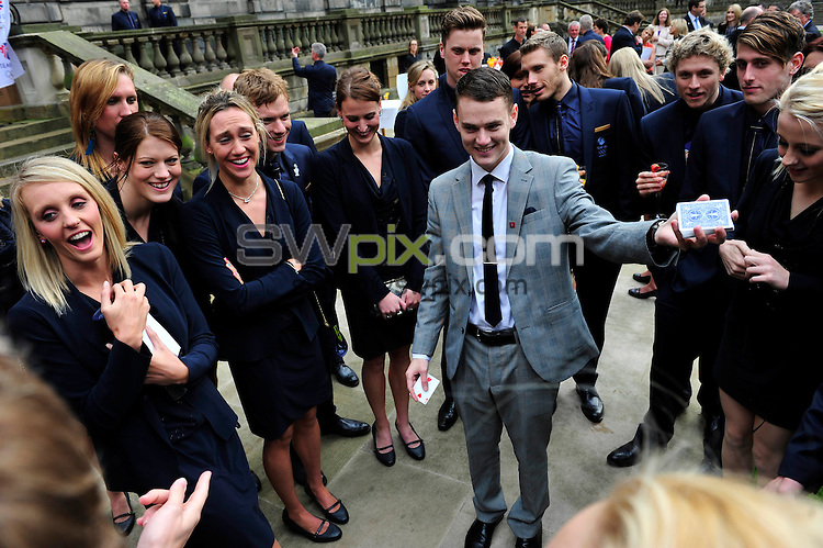 PICTURE BY SIMON WILKINSON/SWPIX.COM - Swimming - Team GB Official Dinner - The Playfair Library, Edinburgh, Scotland - 21/07/12 - Great Britain's Elizabeth Simmonds, Stephanie Proud, Craig Gibbons, Daniel Fogg, Roberto Pavoni, Chris Walker-Hebborn, Siobhan-Marie O'Connor and Marco Loughran watch a Magician.