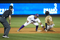 Winston-Salem Dash shortstop Yeyson Yrizarri (2) applies the tag to Eric Jenkins (12) of the Down East Wood Ducks as base umpire Mark Bass looks on at BB&T Ballpark on May 12, 2018 in Winston-Salem, North Carolina. The Wood Ducks defeated the Dash 7-5. (Brian Westerholt/Four Seam Images)