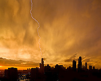 A passing storm creates lightning striking on the city of Chicago skyscrapers.