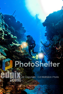 20 June 2016: SCUBA Divers Sally Herschorn and Josh Wolfstein swim through a ravine adjacent the Wreck of the Doc Poulson off the shores of 7-Mile Beach on the West side of Grand Cayman Island. Located in the British West Indies in the Caribbean, the Cayman Islands are renowned for excellent scuba diving, snorkeling, beaches and international banking.  Mandatory Credit: Ed Wolfstein Photo *** RAW (NEF) Image File Available ***