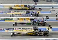 Apr. 15, 2012; Concord, NC, USA: NHRA top fuel dragster drivers (top to bottom) Spencer Massey , Antron Brown , Hillary Will and Morgan Lucas race four wide during eliminations for the Four Wide Nationals at zMax Dragway. Mandatory Credit: Mark J. Rebilas-
