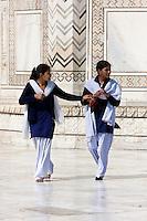 Agra, India.  Taj Mahal.  Two Young Indian Women Wearing Shalwar (Long Trousers) and Kameez (Long, Loose-fitting Shirt).