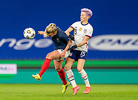 LE HAVRE, FRANCE - APRIL 13: Marion Torrent #4 of France is defended by Megan Rapinoe #15 of the USWNT during a game between France and USWNT at Stade Oceane on April 13, 2021 in Le Havre, France.