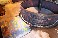 Chateau Mire l'Etang. La Clape. Languedoc. Wine press. An old vertical basket press. France. Europe.