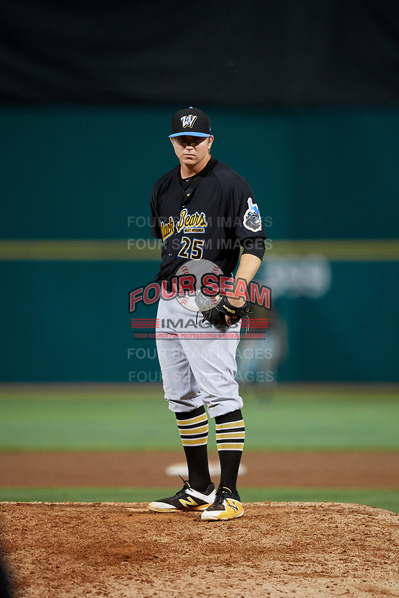 West Virginia Black Bears relief pitcher Conner Loeprich (25) looks in for the sign during a game against the State College Spikes on August 30, 2018 at Medlar Field at Lubrano Park in State College, Pennsylvania.  West Virginia defeated State College 5-3.  (Mike Janes/Four Seam Images)