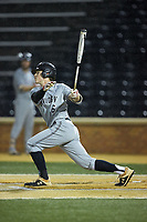 Eric Jones (6) of the Davidson Wildcats follows through on his swing against the Wake Forest Demon Deacons at David F. Couch Ballpark on May 7, 2019 in  Winston-Salem, North Carolina. The Demon Deacons defeated the Wildcats 11-8. (Brian Westerholt/Four Seam Images)