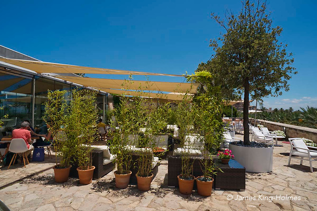 Exterior table area at the restaurant at Es Baluard art museum, Palma de Mallorca, Spain. The restaurant is situated overlooking the city from the 16th Century fort of Sant Pere.