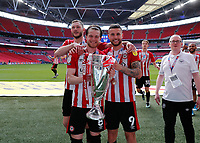 29th May 2021; Wembley Stadium, London, England; English Football League Championship Football, Playoff Final, Brentford FC versus Swansea City; Emiliano Marcondes, Mathias Jensen and Henrik Dalsgaard of Brentford all celebrates with the Sky Bet EFL Championship Plays-off Trophyv
