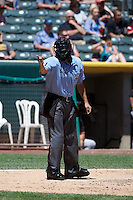 Home plate umpire Alex Ortiz during the game between the Fresno Grizzlies and the Salt Lake Bees in Pacific Coast League action at Smith's Ballpark on May 26, 2014 in Salt Lake City, Utah.  (Stephen Smith/Four Seam Images)