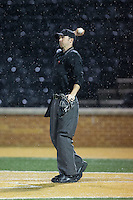Home plate umpire Thomas Newsom throws a new baseball to the pitcher during the NCAA baseball game between the Davidson Wildcats and the Wake Forest Demon Deacons at David F. Couch Ballpark on February 28, 2017 in Winston-Salem, North Carolina.  The Demon Deacons defeated the Wildcats 13-5.  (Brian Westerholt/Four Seam Images)
