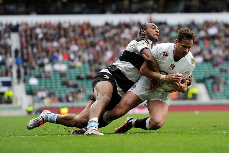 Danny Cipriani of England touches down despite the efforts of Joe Rokocoko of Barbarians during the match between England and Barbarians at Twickenham Stadium on Sunday 31st May 2015 (Photo by Rob Munro)