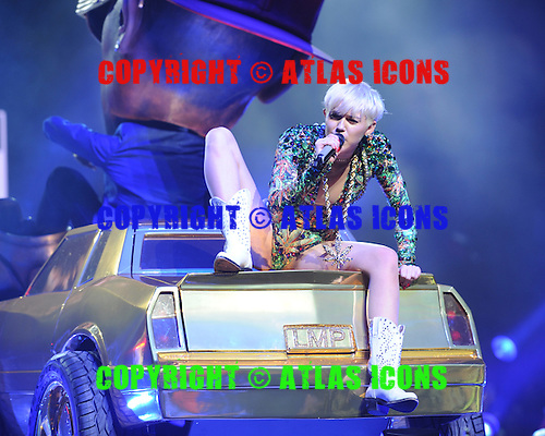 MIAMI, FL - MARCH 11:  Miley Cyrus performs at the AmericanAirlines Arena on March 22, 2014 in Miami Florida. Credit Larry Marano (C) 2014