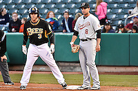 J.B. Shuck (3) of the Salt Lake Bees and Anthony Aliotti (8) of the Sacramento River Cats during the game at Smith's Ballpark on April 5, 2014 in Salt Lake City, Utah.  (Stephen Smith/Four Seam Images)