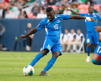 DENVER, CO - JUNE 19: Mickael Biron #10 shoots on goal during a game between Martinique and Cuba at Broncos Stadium on June 19, 2019 in Denver, Colorado.