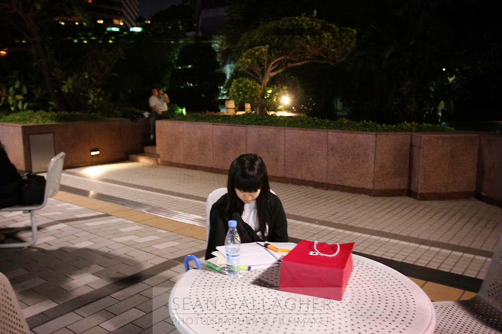 CHINA. Hong Kong. Schollchild sitting alone in Kowloon. Officially the Hong Kong Special Administrative Region, it is a territory located on China's south coast on the Pearl River Delta. It has a population of 6.9 million people, and is one of the most densely populated areas in the world. 2008