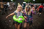 © Joel Goodman - 07973 332324 . . 12/06/2016 . Manchester , UK . Two women cross the mud at the Parklife music festival at Heaton Park in Manchester . Photo credit : Joel Goodman