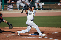 Michael Berglund (15) of the Charleston RiverDogs follows through on his swing against the Augusta GreenJackets at Joseph P. Riley, Jr. Park on June 27, 2021 in Charleston, South Carolina. (Brian Westerholt/Four Seam Images)