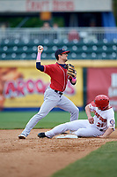 New Hampshire Fisher Cats second baseman Cavan Biggio (6) turns a double play as Dan Gamache (21) slides into second base during the first game of a doubleheader against the Harrisburg Senators on May 13, 2018 at FNB Field in Harrisburg, Pennsylvania.  New Hampshire defeated Harrisburg 6-1.  (Mike Janes/Four Seam Images)