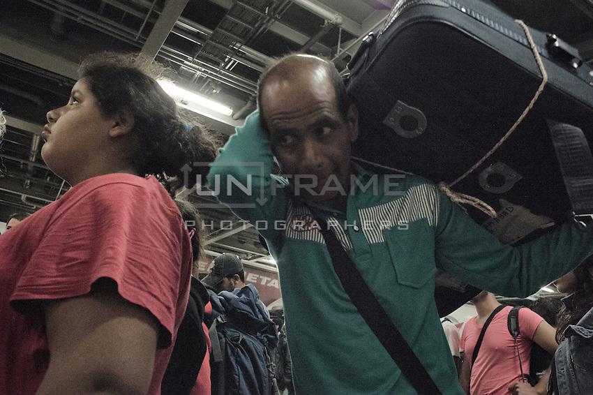 Syrian migrants on a ferry arrive in Athens and prepare for their next journey to MAcedonia. Athens, Greece. Sept. 8, 2015