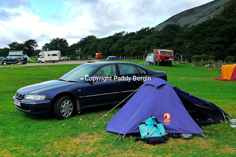 Lochranza Campsite is a small, friendly campsite in an awe-inspiring location at the north-west end of the Isle of Arran. A small Calmac ferry shuttles daily from March to October between Claonaig on Kintyre and Lochranza, though the main ferry route to the island is from Ardrossan, on the North Ayrshire coast, across the Firth of Clyde, to Brodick. From there, it is 14 miles, or half an hour by motor vehicle, to Lochranza by the scenic coast road.<br /> <br /> Stock Photo by Paddy Bergin