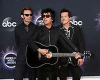 LOS ANGELES - NOV 24:  Green Day - Mike Dirnt, Billie Joe Armstrong, Tre Cool at the 47th American Music Awards - Arrivals at Microsoft Theater on November 24, 2019 in Los Angeles, CA