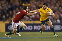 MELBOURNE, 29 JUNE 2013 - Adam ASHLEY-COOPER of the Wallabies protects the ball from Sam WARBURTON, Captain of the Lions during the Second Test match between the Australian Wallabies and the British & Irish Lions at Etihad Stadium on 29 June 2013 in Melbourne, Australia. (Photo Sydney Low / sydlow.com)
