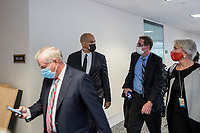 United States Senator Cory Booker (Democrat of New Jersey), second from left, and United States Senator Lindsey Graham (Republican of South Carolina), left, and other Senators evacuate to a safe place in the Dirksen Senate Office Building after Electoral votes being counted during a joint session of the United States Congress to certify the results of the 2020 presidential election in the US House of Representatives Chamber in the US Capitol in Washington, DC on Wednesday, January 6, 2021, as interrupted as thousands of pr-Trump protestors stormed the U.S. Capitol and the House chambers.  .<br /> Credit: Rod Lamkey / CNP/AdMedia