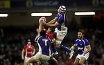 Jamie Roberts under pressure from Daniel Leo and Maurie Fa'Asavalu takes the high ball..Dove Men Series 2012.Wales v Samoa.Millennium Stadium.16.11.12.©Steve Pope - Sportingwales