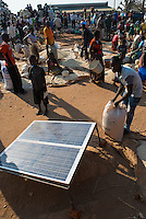 MALAWI, village market, maize and solar panel / MALAWI, Markt in einem Dorf, Mais und Solar Panel