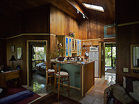 Skylight illuminating wood walls and kitchen of a cabin in Hana, Maui.