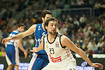 Real Madrid´s Sergio Llull and Anadolu Efes´s Dogus Balbay during 2014-15 Euroleague Basketball match between Real Madrid and Anadolu Efes at Palacio de los Deportes stadium in Madrid, Spain. December 18, 2014. (ALTERPHOTOS/Luis Fernandez)
