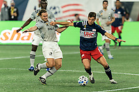 FOXBOROUGH, MA - SEPTEMBER 23: Matt Polster #8 of New England Revolution fends off defender Samuel Piette #6 of Montreal Impact during a game between Montreal Impact and New England Revolution at Gillette Stadium on September 23, 2020 in Foxborough, Massachusetts.